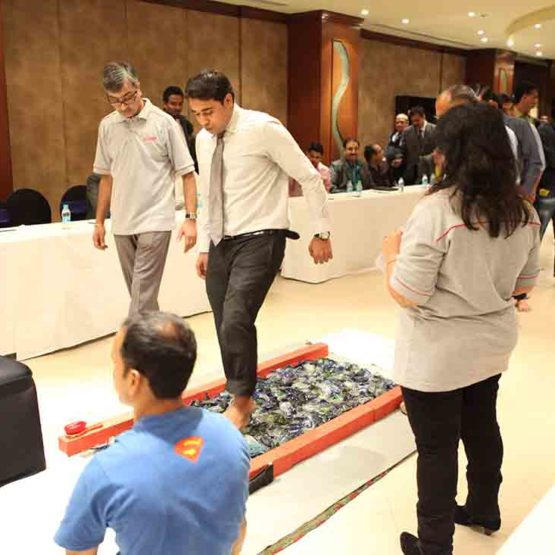Motivational Exercise | glass walking at Sales & Distributor meets planned by Pegasus Events Pvt Ltd